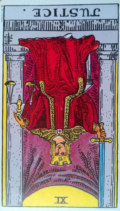 Inverted Justice Tarot Card Meaning (Reversed) – Major Arcana